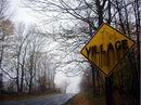Creepy village sign.jpg
