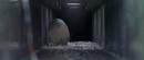 Godzilla vs. Megaguirus - Meganulon Egg gets thrown down sewer.png