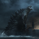 G14 - Godzilla with M.U.T.O.'s head in his hands.png