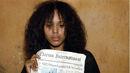 4x11 - Olivia with Newspaper.jpg