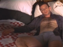 Urbania Charlie (Dan Futterman) shown at the beginning of the film alone in bed.png