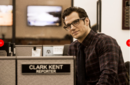 Clark Kent at his Daily Planet desk.png