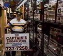 The Captain (Bargain store owner)