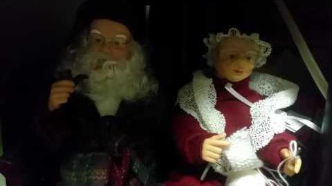 Gemmy Animated Singing Santa & Mrs. Claus On Couch