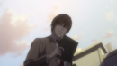 Light Holding Death Note.png