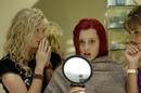 Emma Looking Into Mirror.png