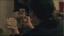 The Stray Elsie finding carved bear.png